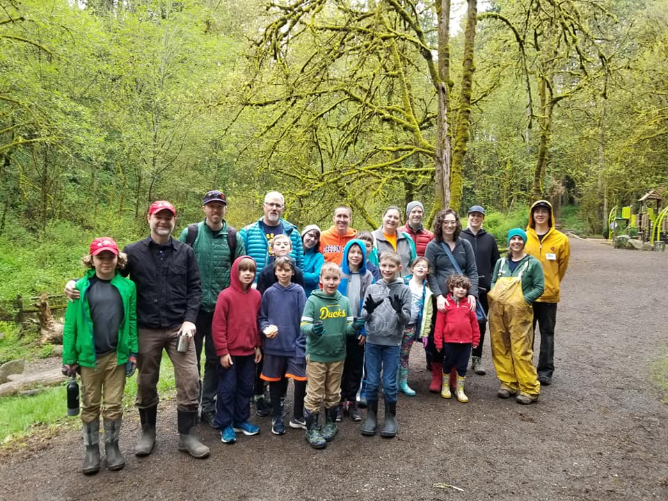A group of 20 people in the forest